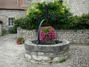 Charroux - Flower-bedecked well; in Bourbonnais