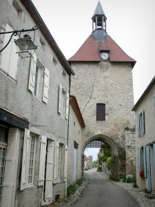 Charroux - Belfry (clock tower) and facades of houses in the Rue de l'Horloge street