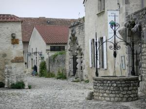 Charroux - Paved street, wells and houses in the village