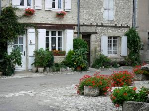 Charroux - Floral decorations (flowers) and facades of houses in the village