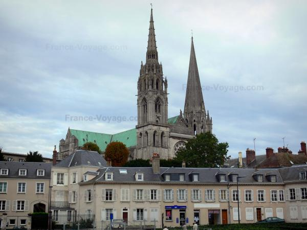 Chartres - Notre-Dame cathedral of Gothic style (western facade) and buildings of the city