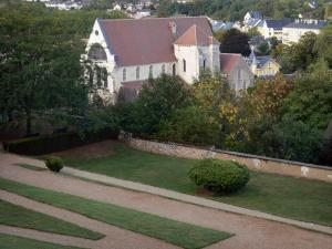 Chartres - Garden of the bishop's palace with view of the Saint-André church, trees, houses and buildings of the city