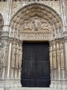 Chartres - Notre-Dame cathedral: central door of the Royal portal (western facade of the Gothic building) with its tympanums (statuary, sculptures)