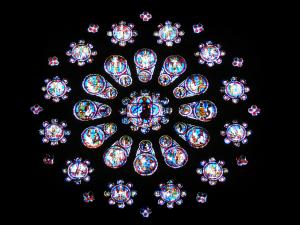 Chartres - Inside of the Notre-Dame cathedral (Gothic building): stained glass windows of the western rose window
