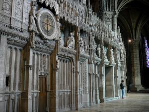 Chartres - Inside of the Notre-Dame cathedral (Gothic building): fence of the chancel (tower) with its astronomical clock and its statues (statuary)