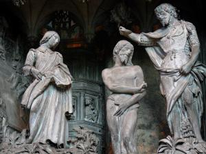 Chartres - Inside of the Notre-Dame cathedral (Gothic building): statues (statuary) of the fence of the chancel (tower)