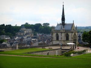 Château d'Amboise - Saint-Hubert chapel of Flamboyant Gothic style, lawns and terrace with view of the roofs of the city and the Saint-Denis church