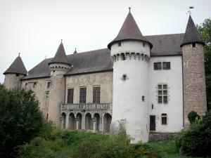 Château d'Aulteribe - Towers, battlements and facade of a medieval castle; in Sermentizon, in the Livradois-Forez Regional Nature Park