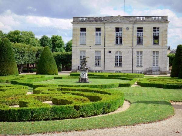 Château de Bouges - Facade of the château and French-style formal garden; in the town of Bouges-le-Château