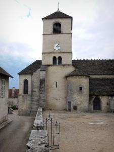 Château-Chalon - Saint-Pierre romanesque church with its bell tower, wicket, street and houses