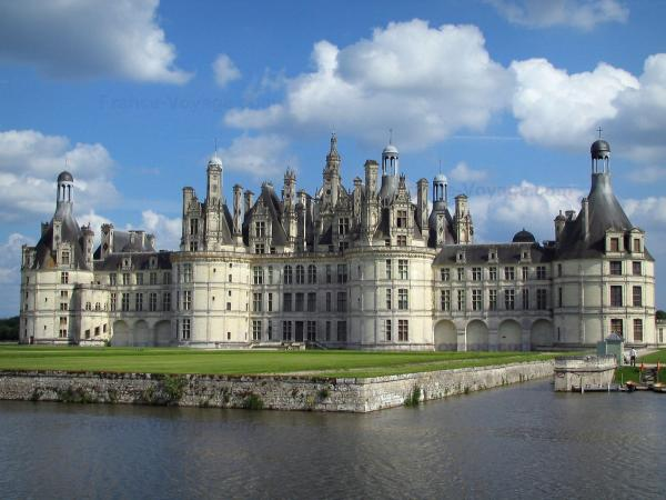 Château de Chambord - Renaissance Château, lawns, canal, and clouds in the blue sky