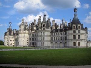 Château de Chambord - Renaissance Château, lawns, and clouds in the blue sky