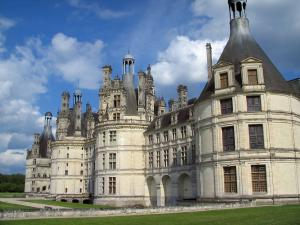 Château de Chambord - Renaissance Château, lawns, and the in the blue sky