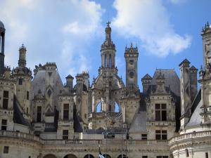Château de Chambord - Tower and chimneys of the Renaissance Château, clouds in the blue sky