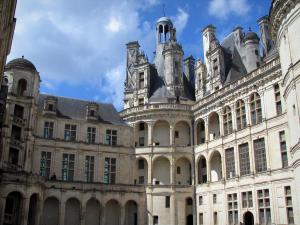 Château de Chambord - Renaissance Château: watch tower of the keep and galleries, clouds in the blue sky