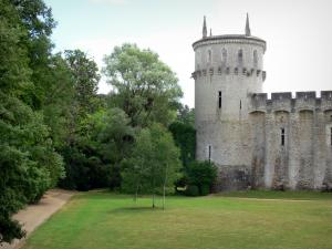 Château-Guillaume - Tower and walls of the medieval fortress, lawn and trees; in the town of Lignac, in the Allemette valley in La Brenne Regional Nature Park