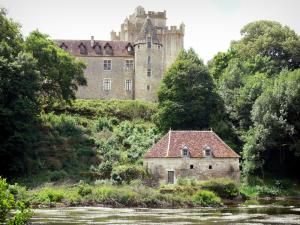 Château de Romefort - Castle, River Creuse, mill and trees; in the town of Ciron, in the Creuse valley, in La Brenne Regional Nature Park