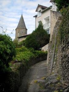 Châteauponsac - Narrow sloping alleyway, bell tower of the Saint-Thyrse church and a house, in Basse-Marche (Gartempe valley)
