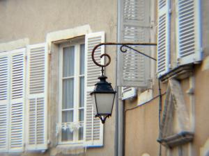 Châteauroux - Lamppost and windows of houses in the old town