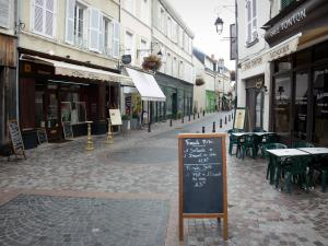Châteauroux - Shopping street, facades of houses, restaurant terrace and shops