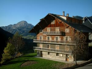Châtel - Wooden chalet, garden, trees and mountain in background, in Chablais