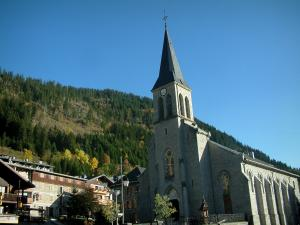 Châtel - Church, houses of the village (winter and summer sports resort) and forest, in Chablais