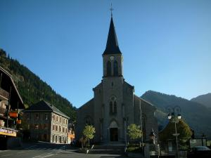 Châtel - Church, houses of the village (winter and summer sports resort) and mountains covered with forests, in Chablais
