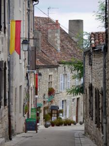 Chauvigny - Sloping narrow street of the upper town (medieval town) lined with stone houses