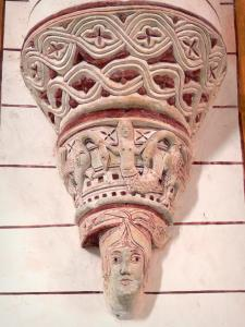 Chauvigny - Inside of the Saint-Pierre collegiate church (Romanesque church): carved tailpiece (sculpture)
