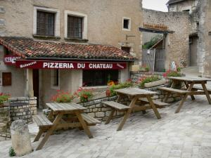 Chauvigny - Restaurant terrace and houses of the upper town (medieval town)