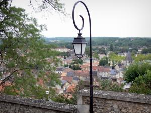 Chauvigny - Lamppost in foreground with view of the roofs of the city, bell tower of the Notre-Dame church and surrounding countryside