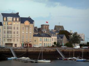 Cherbourg-Octeville - Port with its small moored leisure boats, quay, bell tower of the Sainte-Trinité basilica, houses and buildings of the city