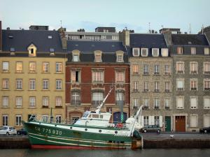 Cherbourg-Octeville - Boat moored to the quay and buildings of the city