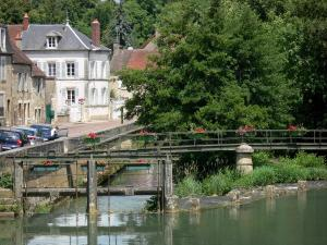 Clamecy - River Beuvron, flower-bedecked gateway, greenery and facades of houses in the town