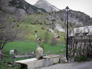 Clarée valley - Fountain, lamppost and house of the village of Névache and mountains