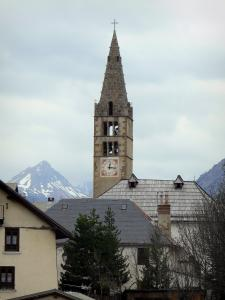 Clarée valley - Village of Val-des-Prés: bell tower of the Saint-Claude church, houses, trees and mountains