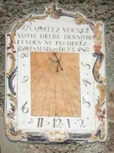 Clarée valley - Village of Plampinet: painted sundial decorating the facade of the Saint-Sébastien church