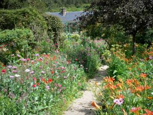 Claude Monet's house and gardens - Monet's garden, in Giverny: Norman enclosure: path lined with flowerbeds