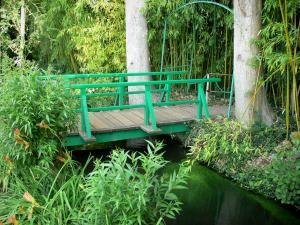 Claude Monet's house and gardens - Monet's garden, in Giverny: water garden: small bridge and green bamboo
