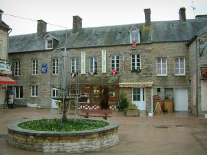 Clécy - Square featuring a fountain and houses of the village in Suisse Normande (an area reminiscent of Switzerland)