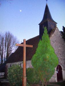 Clermont-en-Auge chapel - Chapel, trees, shrubs, and wooden cross in the Pays d'Auge area