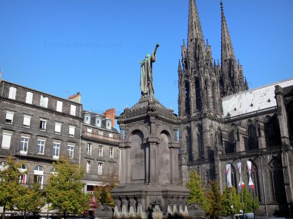 Clermont-Ferrand - Notre-Dame-de-l'Assomption cathedral of Gothic style made of lava stone, with its two steeples, Victoire square with the statue of Urbain II and facades of buildings of the old town