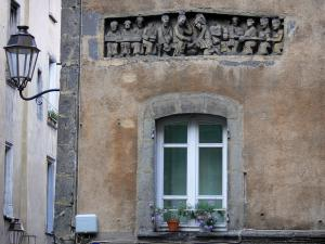 Clermont-Ferrand - Facade of a house decorated with a bas-relief (sculptured artwork), flower-decked window and lamppost