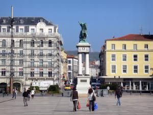 Clermont-Ferrand - Jaude square: equestrian statue of Vercingetorix, shops and facades of buildings