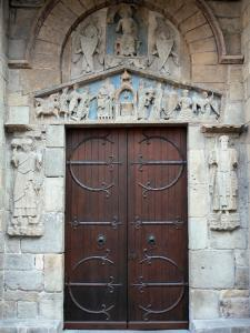 Clermont-Ferrand - Portal of the Romanesque basilica of Notre-Dame-du-Port and its carved tympanum