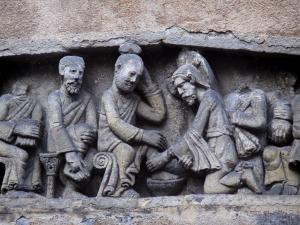 Clermont-Ferrand - Bas-relief (sculptured artwork) representing the washing of feet scene on the facade of a house in the old city
