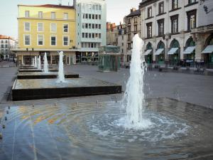 Clermont-Ferrand - Water fountains of the Jaude square, shops and facades of buildings