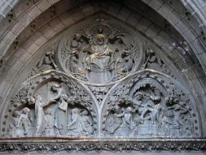 Clermont-Ferrand - Tympanum of the portal of Notre-Dame-de-l'Assomption cathedral of Gothic style