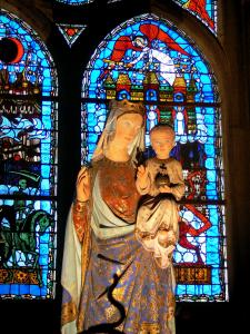Clermont-Ferrand - Inside the Notre-Dame-de-l'Assomption cathedral of Gothic style: Virgin and Child, stained glass windows