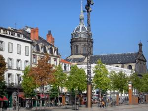 Clermont-Ferrand - Jaude square: tram station, trees, buildings and dome of the Saint-Pierre-les-Minimes church